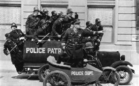 The Keystone Kops on the road,  in their antiquated vehicles